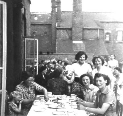 Joan & Mollie serving tea to Mum, sister Margaret, Kathleen & Mrs Illingworth